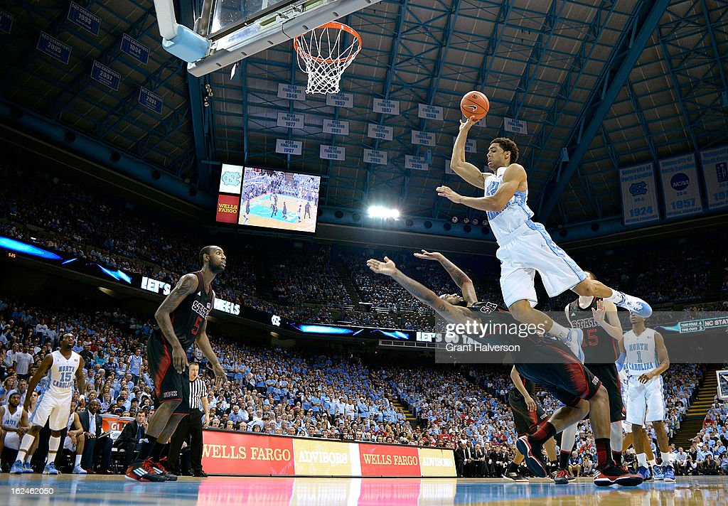 James Michael McAdoo #43 of the North Carolina Tar Heels drives to the basket against <a gi-track='captionPersonalityLinkClicked' href=/galleries/search?phrase=Richard+Howell&family=editorial&specificpeople=2313901 ng-click='$event.stopPropagation()'>Richard Howell</a> #1 of the North Carolina State Wolfpack during play at the Dean Smith Center on February 23, 2013 in Chapel Hill, North Carolina. North Carolina won 76-65.