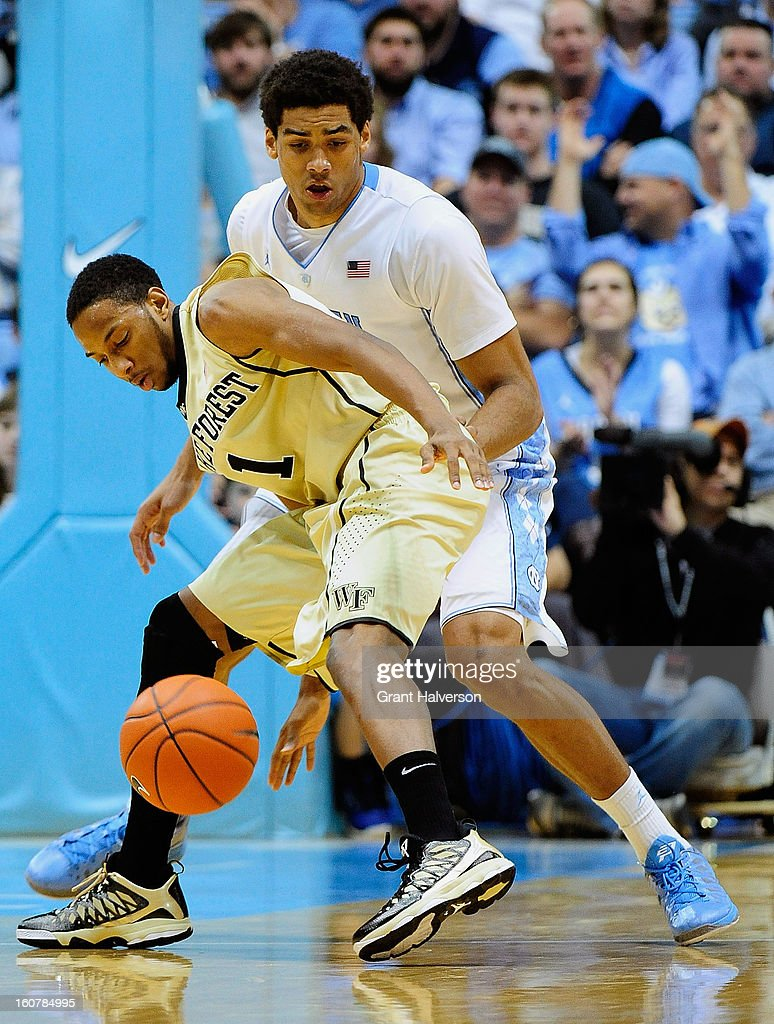 James Michael McAdoo #43 of the North Carolina Tar Heels forces a turnover by Madison Jones #1 of the Wake Forest Demon Deacons during play at the Dean Smith Center on February 5, 2013 in Chapel Hill, North Carolina. North Carolina won 87-62.