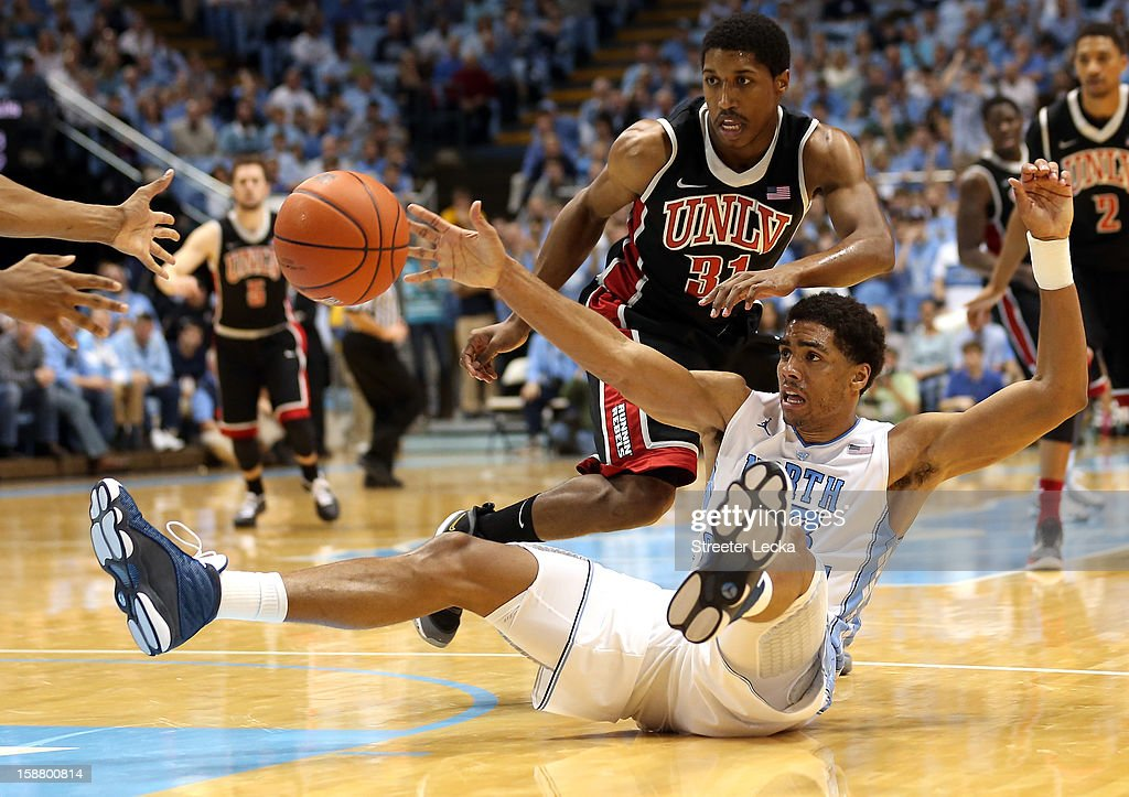 James Michael McAdoo #43 of the North Carolina Tar Heels goes after a loose ball with Justin Hawkins #31 of the UNLV Rebels during their game at Dean Smith Center on December 29, 2012 in Chapel Hill, North Carolina.