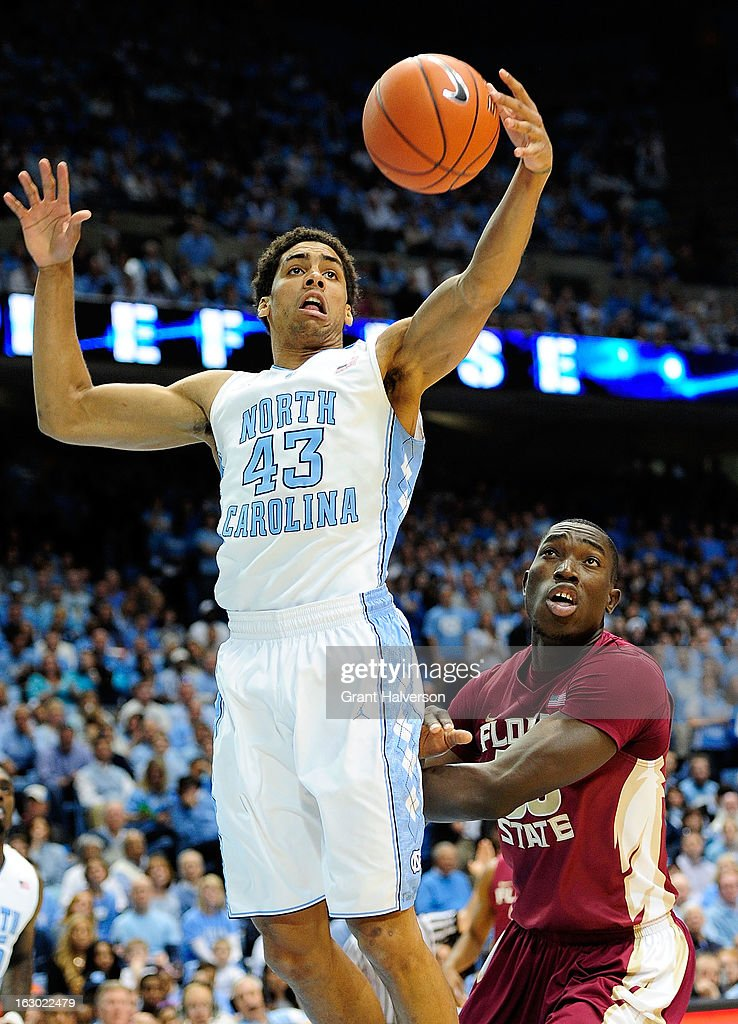 James Michael McAdoo #43 of the North Carolina Tar Heels pullsdown a rebound in front of Ian Miller #30 of the Florida State Seminoles during play at Dean Smith Center on March 3, 2013 in Chapel Hill, North Carolina. North Carolina won 79-58.