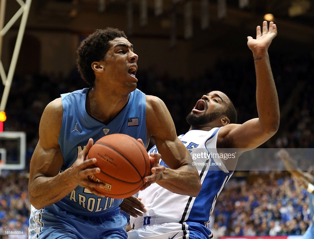James Michael McAdoo #43 of the North Carolina Tar Heels runs into Josh Hairston #15 of the Duke Blue Devils during their game at Cameron Indoor Stadium on February 13, 2013 in Durham, North Carolina.