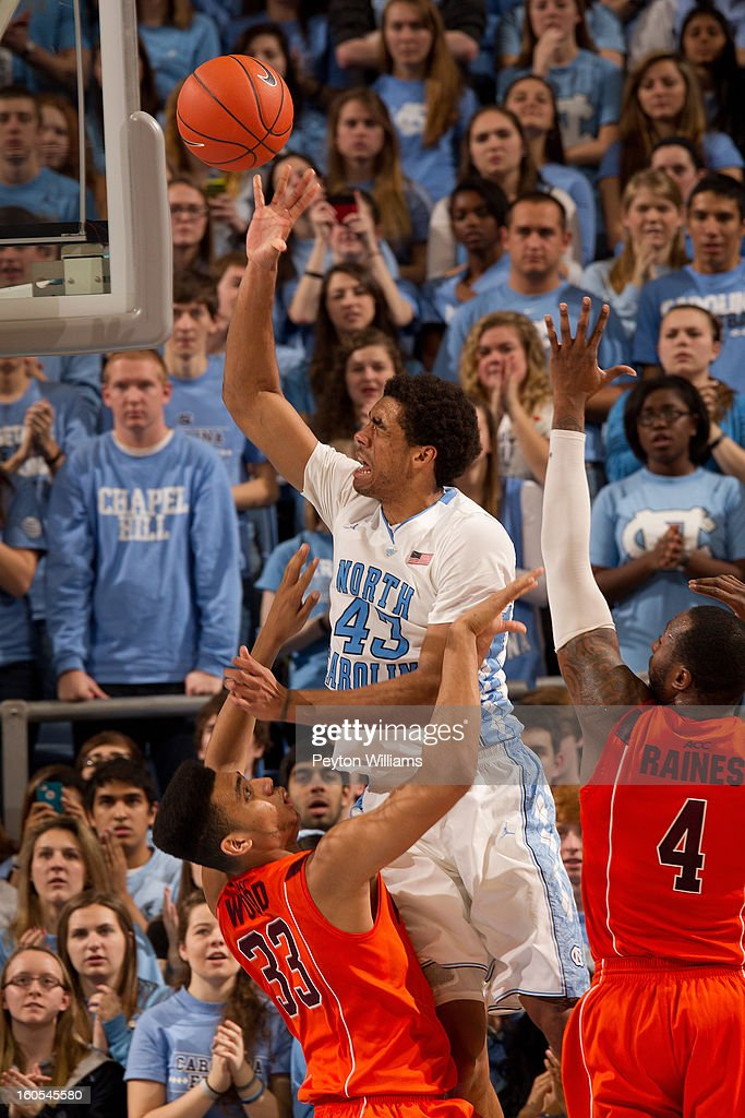 James Michael McAdoo #43 of the North Carolina Tar Heels shoots over forward Marshall Wood #33 of the Virginia Tech Hokies after getting his eye poked and injured on February 02, 2013 at the Dean E. Smith Center in Chapel Hill, North Carolina. North Carolina won 60-72 in overtime.