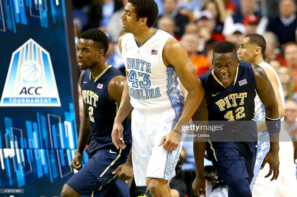 James Michael McAdoo #43 of the North Carolina Tar Heels watches as Talib Zanna #42 of the Pittsburgh Panthers celebrates after a basket during the quarterfinals of the 2014 Men's ACC Basketball Tournament at Greensboro Coliseum on March 14, 2014 in Greensboro, North Carolina.