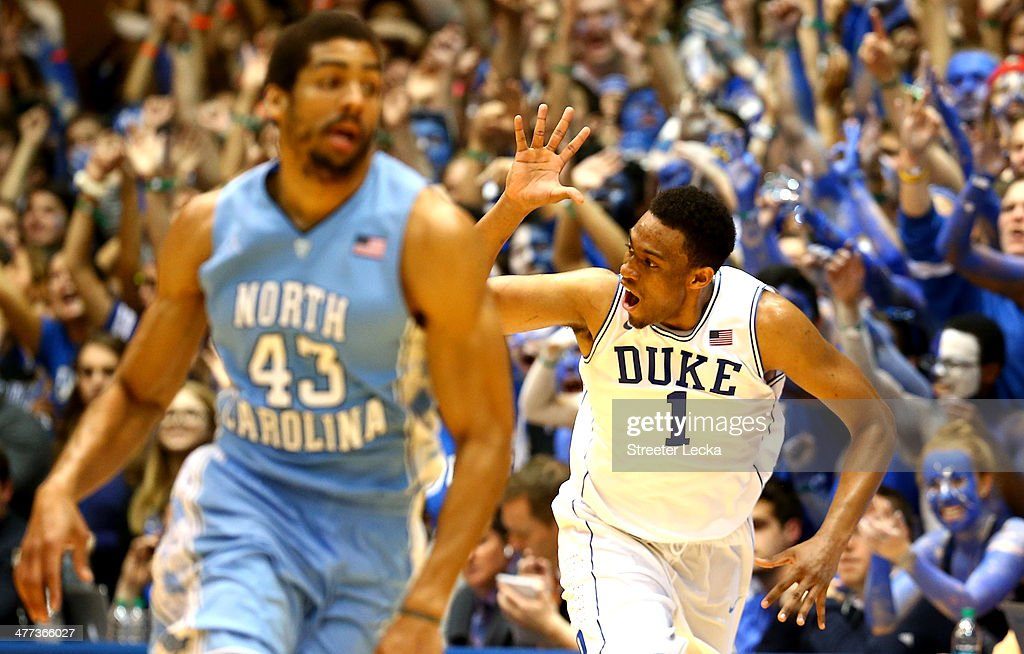 James Michael McAdoo #43 of the North Carolina Tar Heels wtaches as Jabari Parker #1 of the Duke Blue Devils reacts after making a basket during their game at Cameron Indoor Stadium on March 8, 2014 in Durham, North Carolina.
