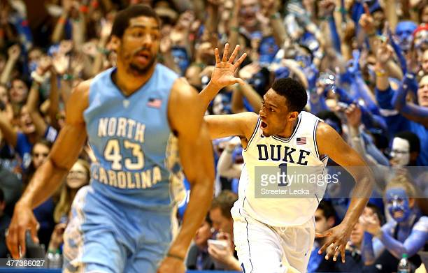 James Michael McAdoo of the North Carolina Tar Heels wtaches as Jabari Parker of the Duke Blue Devils reacts after making a basket during their game...