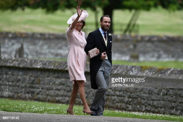 James Middleton brother of the bride walks with his mother Carole Middleton as they attend the wedding of Pippa Middleton and James Matthews at St...