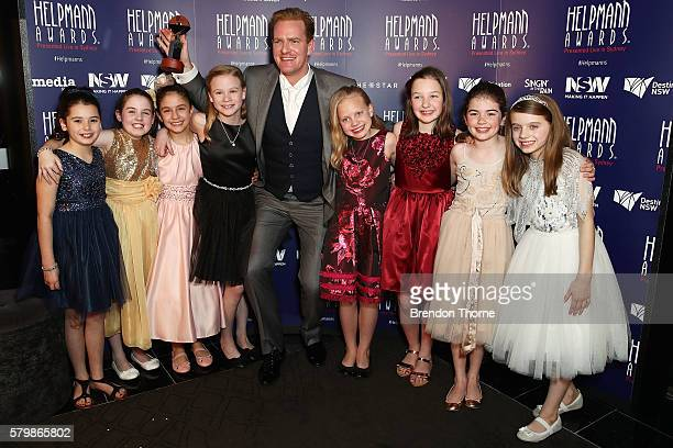 James Millar winner of Best Male Actor in a Musical poses with the Best Female Actor Award recipients the cast of Matilda in the awards room at 16th...