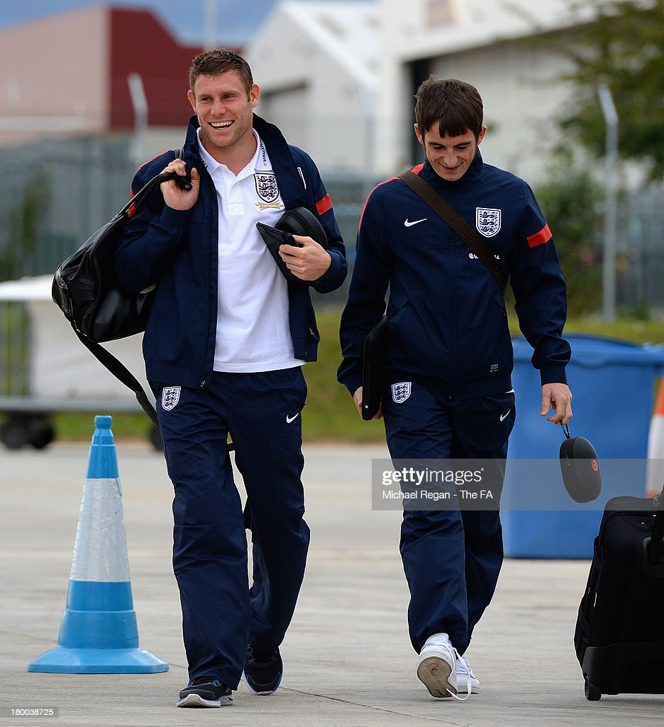 <a gi-track='captionPersonalityLinkClicked' href=/galleries/search?phrase=James+Milner&family=editorial&specificpeople=214576 ng-click='$event.stopPropagation()'>James Milner</a> (L) and <a gi-track='captionPersonalityLinkClicked' href=/galleries/search?phrase=Leighton+Baines&family=editorial&specificpeople=682452 ng-click='$event.stopPropagation()'>Leighton Baines</a> (R) of England board the plane to Kiev after the England press conference at Luton Airport on September 8, 2013 in Hertford, England.