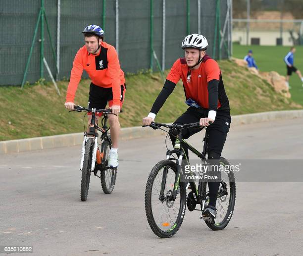 James Milner and Loris Karius of Liverpool arrive on a bikes before the training session at La Manga on February 16 2017 in La Manga Spain