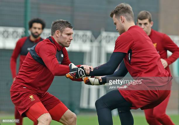 James Milner and Simon Mignolet of Liverpool during training at Melwood Training Ground on September 29 2017 in Liverpool England