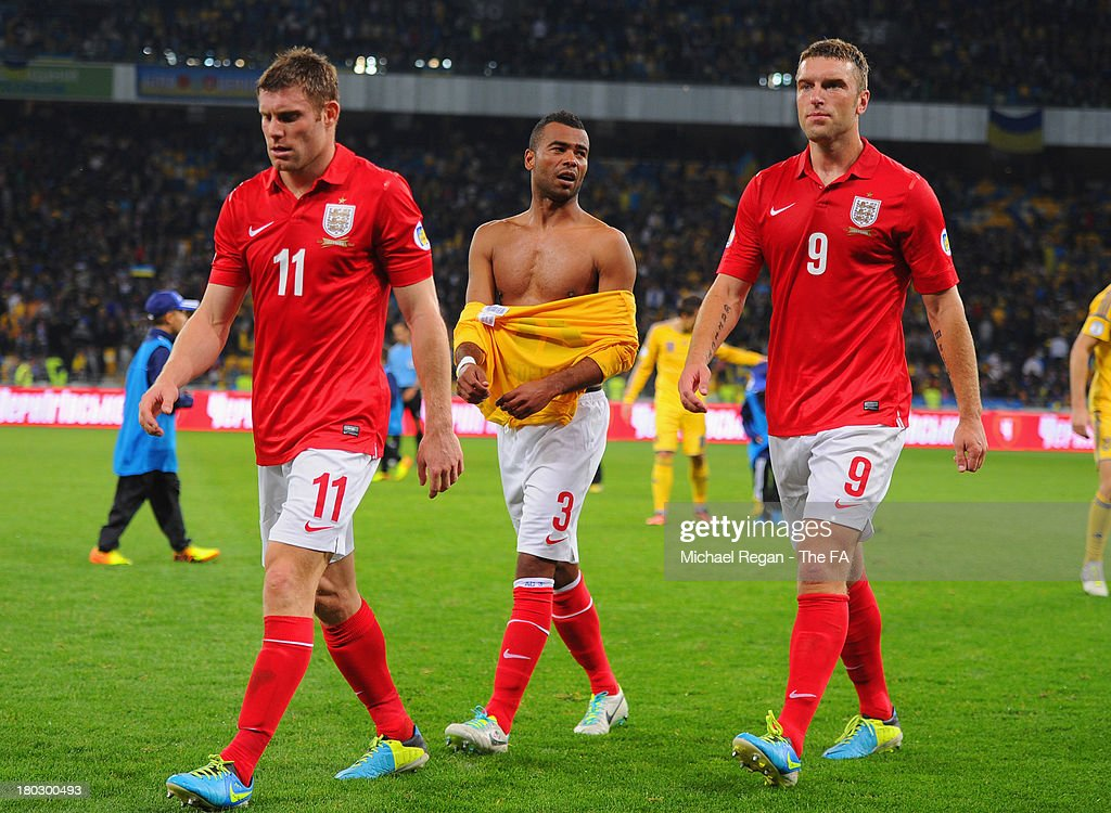 James Milner, Ashley Cole and Rickie Lambert look on after the FIFA 2014 World Cup qualifier at the Olympic Stadium on September 10, 2013 in Kiev, Ukraine.