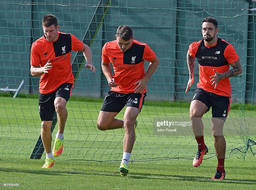 James Milner, Conner Randall and Danny Ings of Liverpool during a training session at Melwood Training Ground on September 18, 2016 in Liverpool, England.