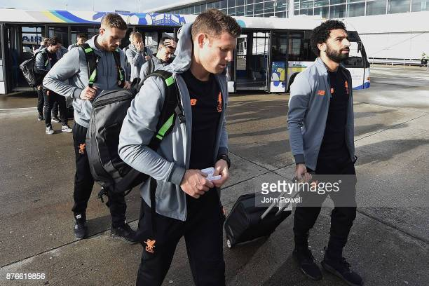 James Milner Mohamed Salah and Jordan Henderson of Liverpool before departing for the group E Champions League match between Sevilla and Liverpool at...