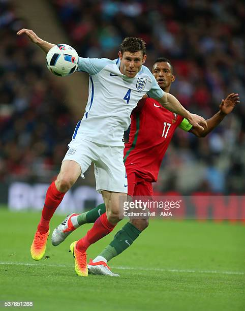 James Milner of England and Nani of Portugal during the International Friendly match between England and Portugal at Wembley Stadium on June 2 2016...