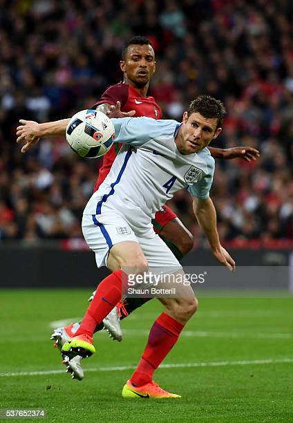 James Milner of England battles with Nani of Portugal during the international friendly match between England and Portugal at Wembley Stadium on June...