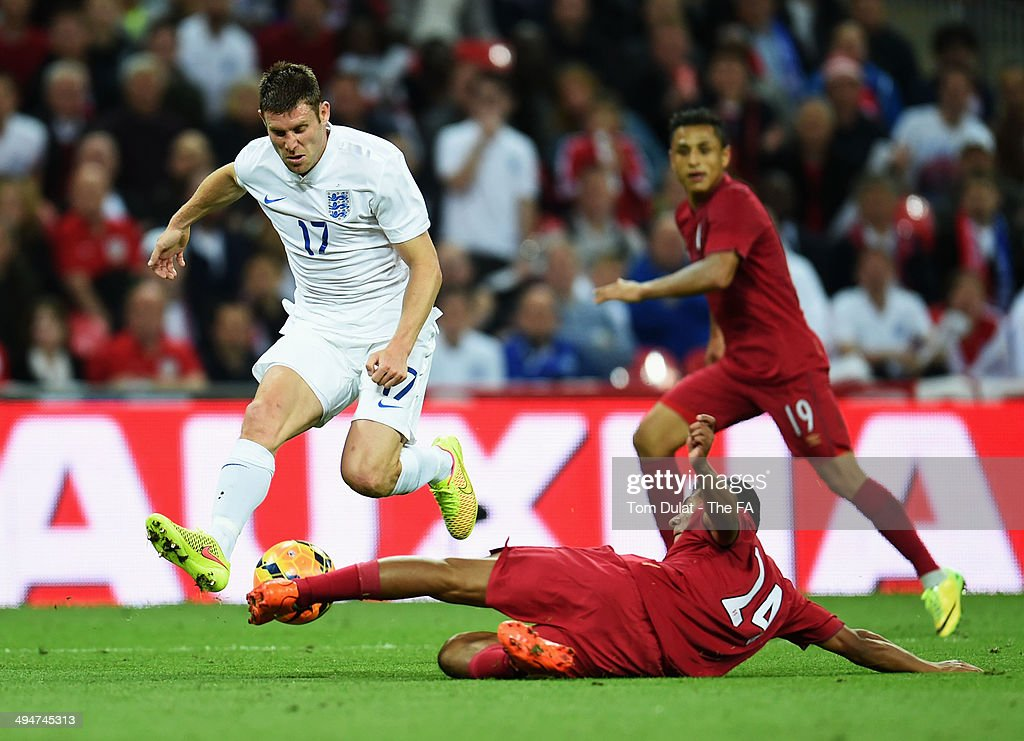 <a gi-track='captionPersonalityLinkClicked' href=/galleries/search?phrase=James+Milner&family=editorial&specificpeople=214576 ng-click='$event.stopPropagation()'>James Milner</a> of England evades <a gi-track='captionPersonalityLinkClicked' href=/galleries/search?phrase=Edison+Flores&family=editorial&specificpeople=8597891 ng-click='$event.stopPropagation()'>Edison Flores</a> of Peru during the International Friendly match between England and Peru at Wembley Stadium on May 30, 2014 in London, England.