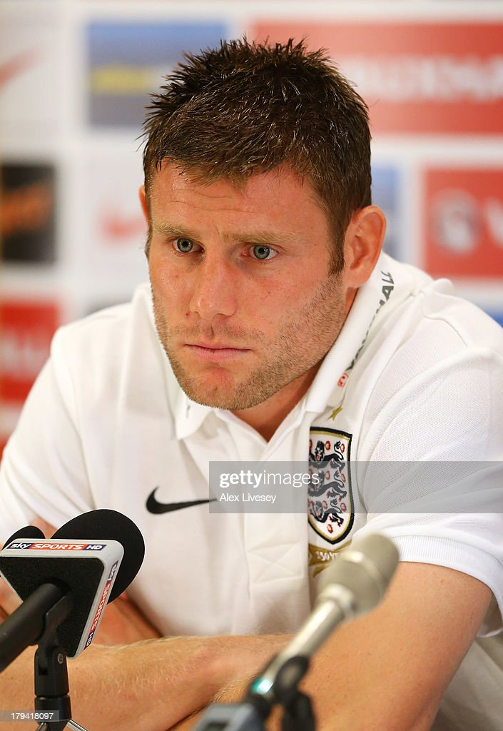 <a gi-track='captionPersonalityLinkClicked' href=/galleries/search?phrase=James+Milner+-+Soccer+Player&family=editorial&specificpeople=214576 ng-click='$event.stopPropagation()'>James Milner</a> of England faces the media during a press conference at St Georges Park on September 3, 2013 in Burton-upon-Trent, England.