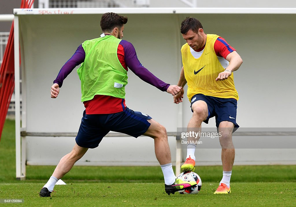 <a gi-track='captionPersonalityLinkClicked' href=/galleries/search?phrase=James+Milner+-+Soccer+Player&family=editorial&specificpeople=214576 ng-click='$event.stopPropagation()'>James Milner</a> of England holds off <a gi-track='captionPersonalityLinkClicked' href=/galleries/search?phrase=Adam+Lallana&family=editorial&specificpeople=5475862 ng-click='$event.stopPropagation()'>Adam Lallana</a> of England during a training session ahead of the UEFA Euro 2016 match against Iceland at Stade du Bourgognes on June 26, 2016 in Chantilly, France.
