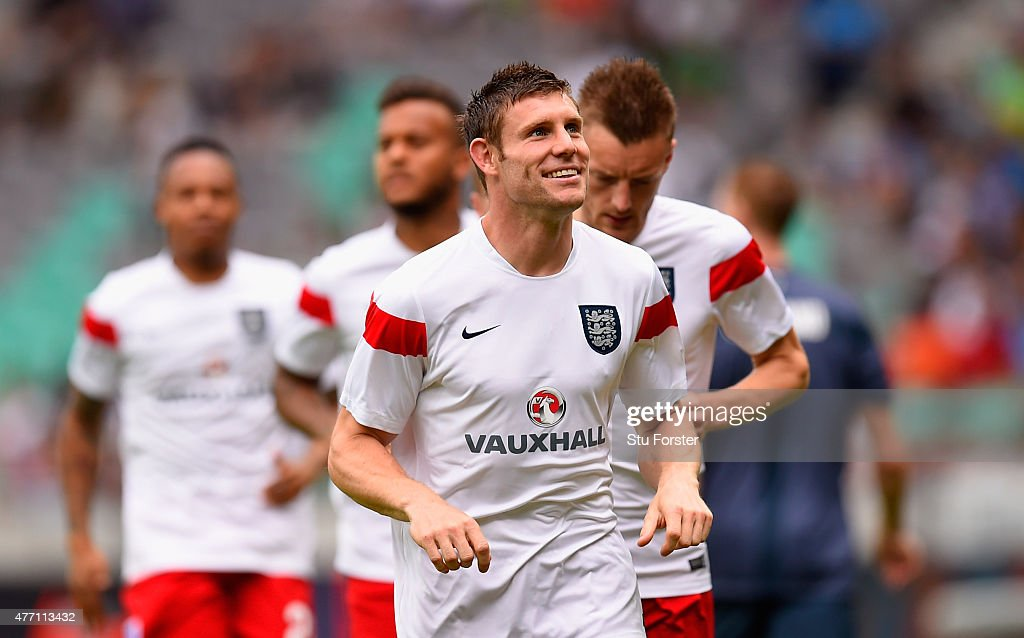 <a gi-track='captionPersonalityLinkClicked' href=/galleries/search?phrase=James+Milner&family=editorial&specificpeople=214576 ng-click='$event.stopPropagation()'>James Milner</a> of England smiles as he warms up ahead of the UEFA EURO 2016 Qualifier between Slovenia and England on at the Stozice Arena on June 14, 2015 in Ljubljana, Slovenia.