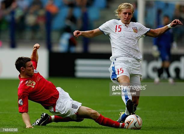 James Milner of England tackles Frantisek Rajtoral of Czech Republic during the UEFA U21 Championship group B match between Czech Republic U21 and...