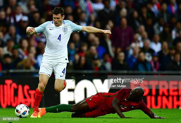 James Milner of England takes on Danilo Pereira of Portugal during the international friendly match between England and Portugal at Wembley Stadium...