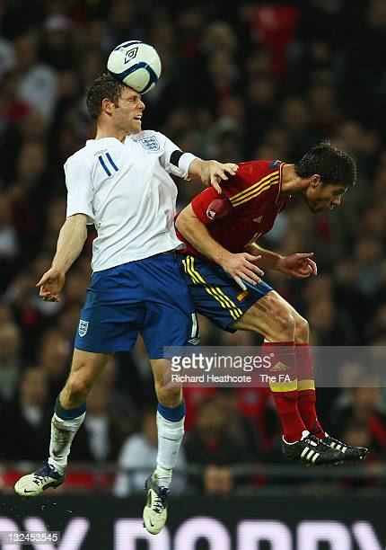 James Milner of England wins a header against Xabi Alonso of Spain during the international friendly match between England and Spain at Wembley...