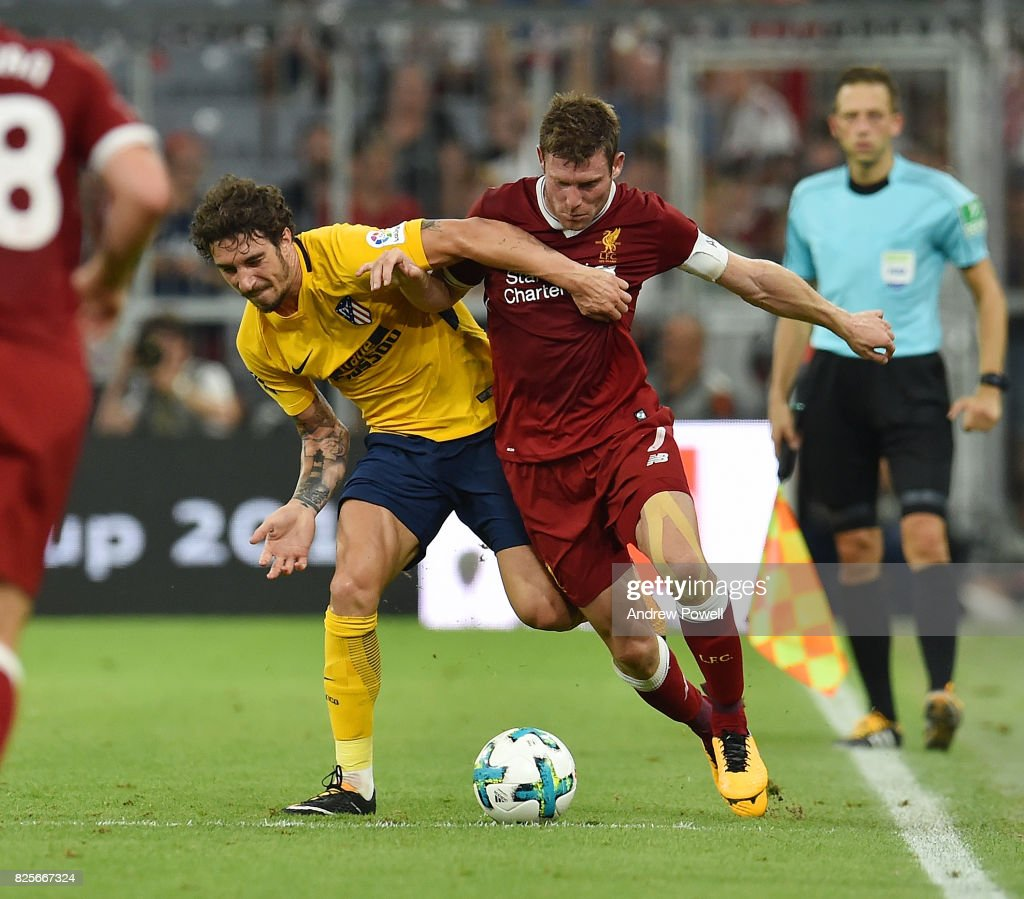 James Milner of Liveprool competes with Sime Vrsaljko of Atletico Madrid during the Audi Cup 2017 match between Liverpool FC and Atletico Madrid at Allianz Arena on August 2, 2017 in Munich, Germany.