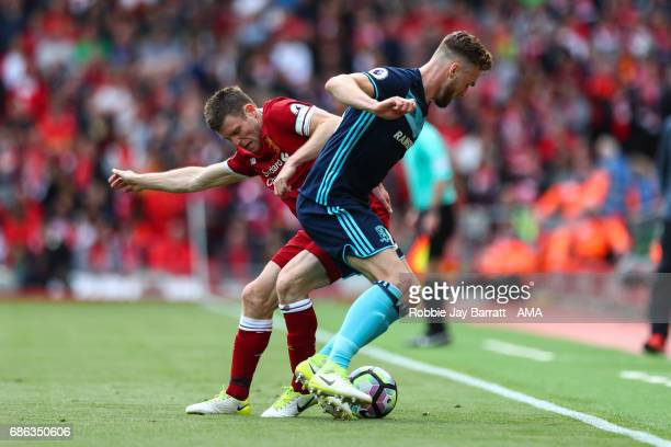 James Milner of Liverpool and Callum Chambers of Middlesbrough during the Premier League match between Liverpool and Middlesbrough at Anfield on May...