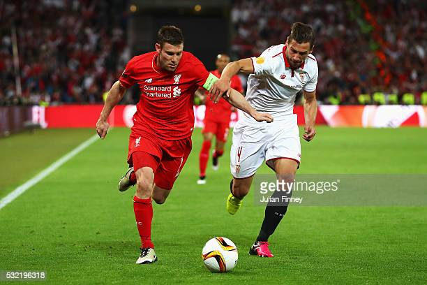 James Milner of Liverpool and Grzegorz Krychowiak of Sevilla compete for the ball during the UEFA Europa League Final match between Liverpool and...