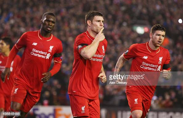 James Milner of Liverpool celebrates as he scores their first and equalising goal from the penalty spot with Christian Benteke and Alberto Moreno...