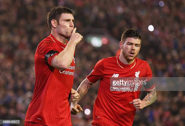James Milner of Liverpool celebrates as he scores their first and equalising goal from the penalty spot with Alberto Moreno during the UEFA Europa...