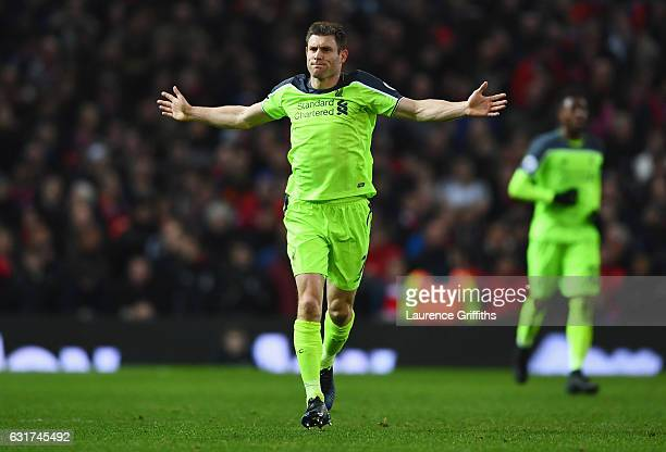 James Milner of Liverpool celebrates as he scores their first goal from a penalty during the Premier League match between Manchester United and...