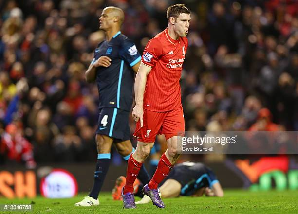 James Milner of Liverpool celebrates scoring his sides second goal as Vincent Kompany of Manchester City stands dejected during the Barclays Premier...