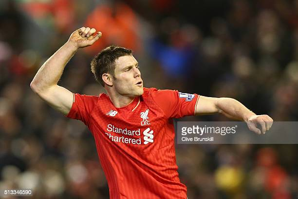 James Milner of Liverpool celebrates scoring his sides second goal during the Barclays Premier League match between Liverpool and Manchester City at...