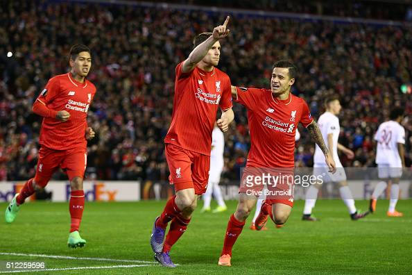 James Milner of Liverpool celebrates scoring his team's first goal with his team mates Roberto Firmino and Philippe Coutinho during the UEFA Europa...