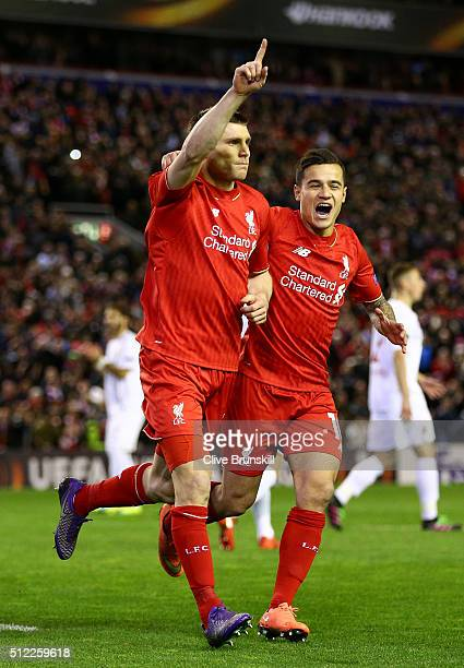James Milner of Liverpool celebrates scoring his team's first goal with his team mate Philippe Coutinho during the UEFA Europa League Round of 32...