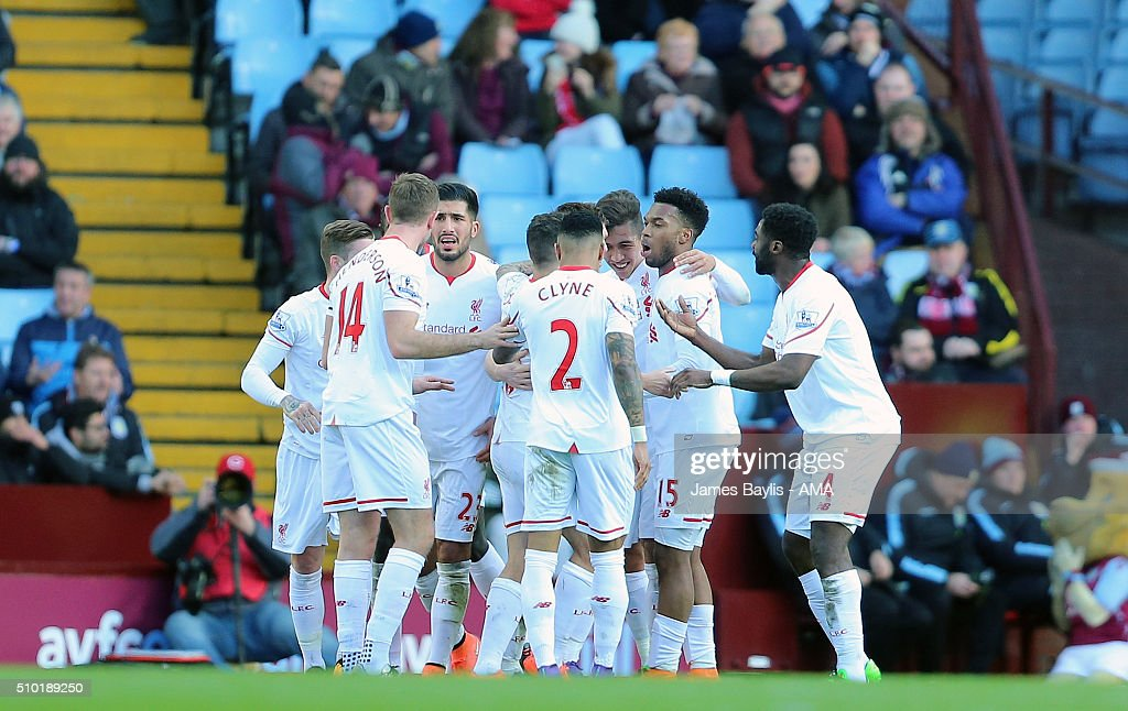 James Milner of Liverpool celebrates with his team-mates after scoring a goal to make it 0-2 during the Barclays Premier League match between Aston Villa and Liverpool at Villa Park on February 14, 2016 in Birmingham, England.