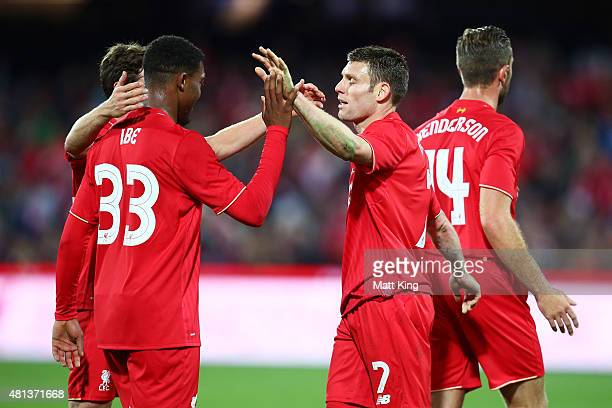 James Milner of Liverpool celebrates with Jordon Ibe after scoring the first goal during the international friendly match between Adelaide United and...
