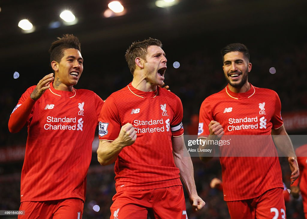 <a gi-track='captionPersonalityLinkClicked' href=/galleries/search?phrase=James+Milner&family=editorial&specificpeople=214576 ng-click='$event.stopPropagation()'>James Milner</a> of Liverpool (C) celebrates with <a gi-track='captionPersonalityLinkClicked' href=/galleries/search?phrase=Roberto+Firmino&family=editorial&specificpeople=7522629 ng-click='$event.stopPropagation()'>Roberto Firmino</a> (L) and <a gi-track='captionPersonalityLinkClicked' href=/galleries/search?phrase=Emre+Can&family=editorial&specificpeople=5909273 ng-click='$event.stopPropagation()'>Emre Can</a> (R) as he scores their first goal from a penalty during the Barclays Premier League match between Liverpool and Swansea City at Anfield on November 29, 2015 in Liverpool, England.