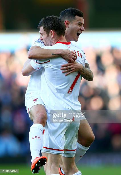 James Milner of Liverpool celebrates with teammate Philippe Coutinho after scoring his team's second goal during the Barclays Premier League match...