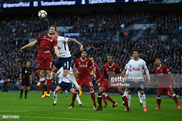 James Milner of Liverpool clears the ball during the Premier League match between Tottenham Hotspur and Liverpool at Wembley Stadium on October 22...