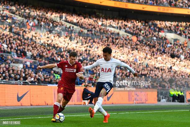 James Milner of Liverpool competes for the ball with Dele Alli of Tottenham Hotspur runs with the ball during the Premier League match between...