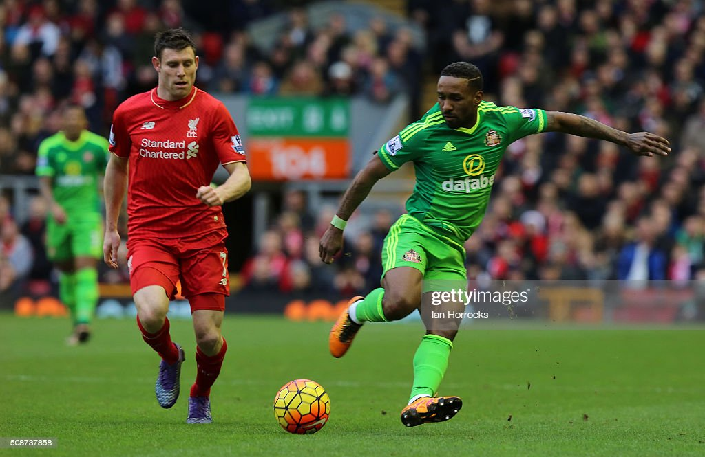 James Milner of Liverpool (L) competes with Jermaine Defoe of Sunderland during the Barclays Premier match between Liverpool and Sunderland at Anfield on February 06, 2016 in Liverpool, England.