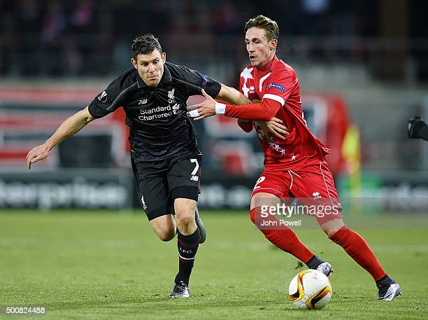 James Milner of Liverpool competes with Vincent Ruefli of FC Sion during the UEFA Europa League match between FC Sion and Liverpool FC at Estadio...