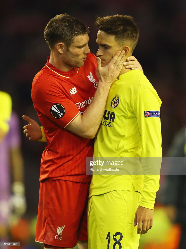 James Milner of Liverpool consoles Denis Suarez of Villarreal after the UEFA Europa League semi final second leg match between Liverpool and Villarreal CF at Anfield on May 5, 2016 in Liverpool, England. Liverpool reach the Europa League Final winning 3-1 on aggregate.