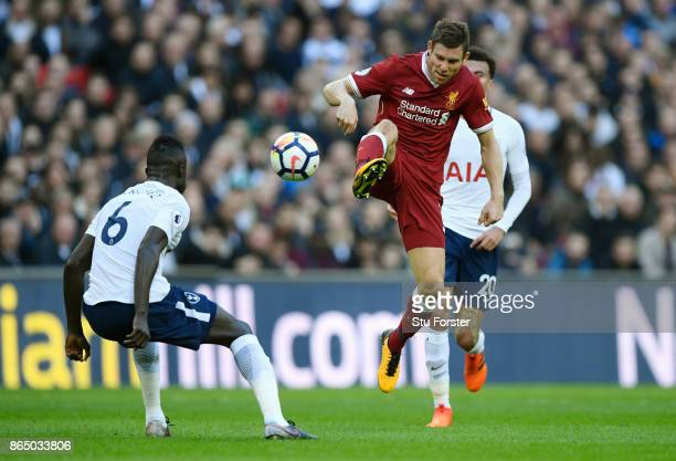 James Milner of Liverpool controls the ball while under pressure from Davinson Sanchez of Tottenham Hotspur during the Premier League match between...