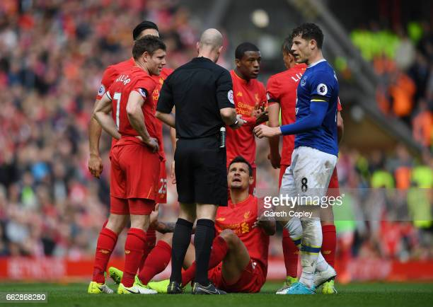 James Milner of Liverpool Dejan Lovren of Liverpool and Ross Barkley of Everton speak to referee Anthony Taylor during the Premier League match...