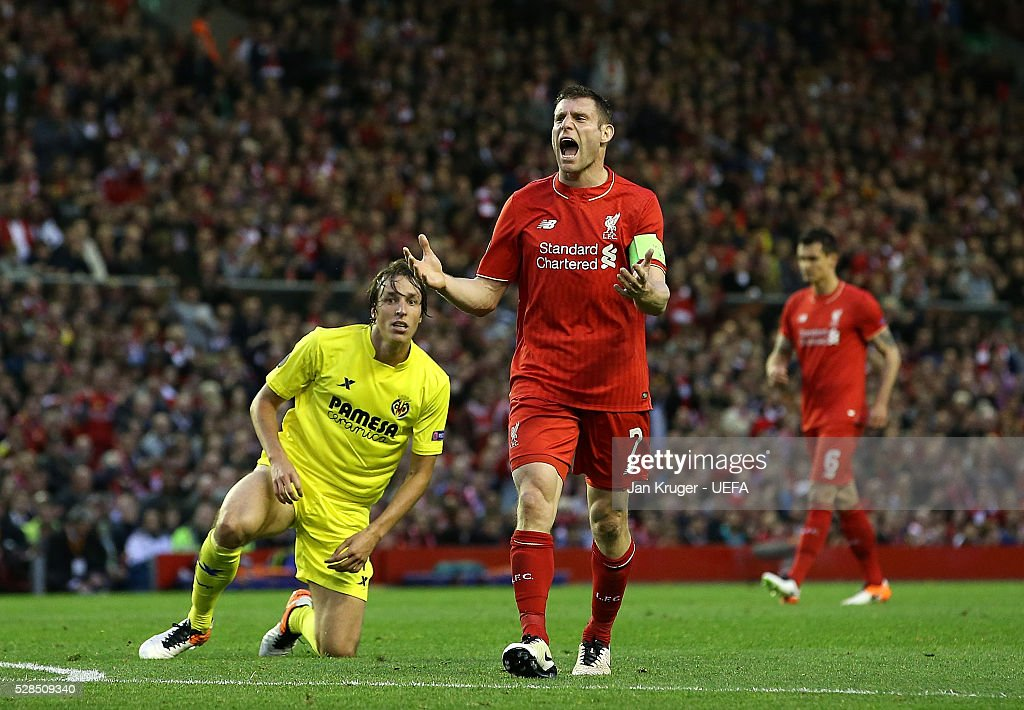 James Milner of Liverpool encourages his team during the UEFA Europa League Semi Final second leg match between Liverpool and Villarreal CF at Anfield on May 05, 2016 in Liverpool, England.