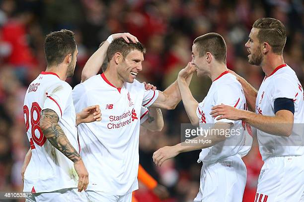 James Milner of Liverpool FC celebrates a goal with team mates during the international friendly match between Brisbane Roar and Liverpool FC at...