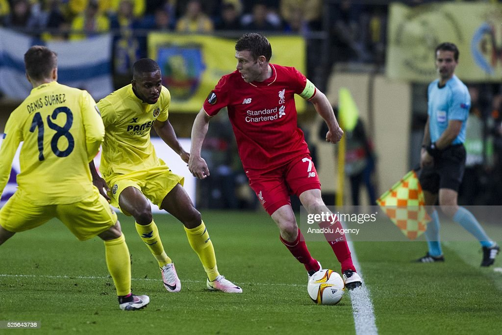 James Milner (R) of Liverpool in action against Denis Suarez (L) of Villareal during the UEFA Europa League Semi Final match between Villarreal and Liverpool at Estadio El Madrigal in Villareal, Spain on April 28, 2016.